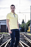 Attractive young man standing on railroad Royalty Free Stock Image