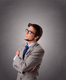 Attractive young man standing and thinking with copy space Stock Images