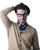 Attractive young man, stylish clothes with black hat and glasses Royalty Free Stock Photo
