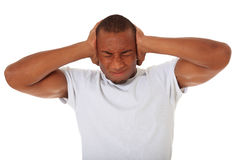 Attractive young man suffers from tinnitus Royalty Free Stock Image