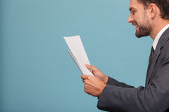 Attractive young man in suit with documents Royalty Free Stock Photography