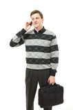 Attractive young man in sweater with phone Royalty Free Stock Image