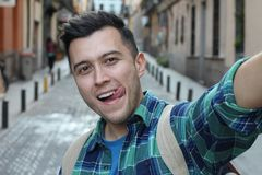 Attractive young man taking a funny selfie royalty free stock photos