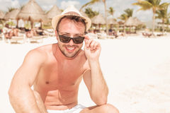 Attractive young man taking off his sunglasses. Stock Images