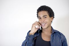 Attractive young man talking on a cell phone. Smiling Royalty Free Stock Photos