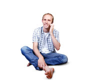Attractive young man talking by mobile phone Royalty Free Stock Image