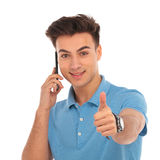 Attractive young man talking on the phone Stock Photos