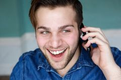 Attractive young man talking on phone Stock Images