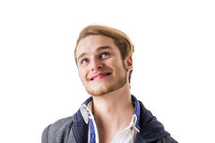 Attractive young man thinking, looking up unsure Stock Photos