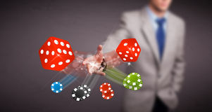 Attractive man throwing dices and chips Royalty Free Stock Photography