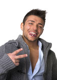 Attractive young man with tongue piercing, doing victory sign Stock Photos