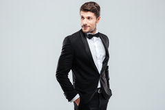 Attractive young man in tuxedo and bowtie Stock Photo