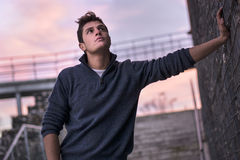 Attractive young man in urban setting, evening time Stock Images