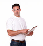 Attractive young man using his tablet pc Royalty Free Stock Photo