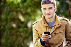 Attractive young man using a mobile phone Stock Photo