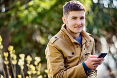 Attractive young man using a mobile phone Stock Photos