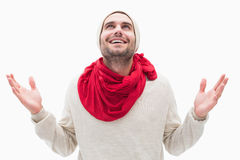 Attractive young man in warm clothes with hands up Stock Images