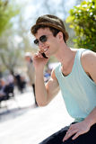 Attractive young man wearing hat talking on the mobile phone. Portrait of an attractive young man wearing hat talking on the mobile phone Royalty Free Stock Image