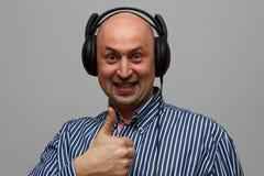 Attractive young man wearing headphones Stock Image