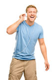 Attractive young man wearing headphones on white background Stock Photo
