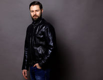 Attractive Young Man Wearing Leather Jacket on gray Stock Photography