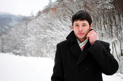 Attractive young man in winter time Royalty Free Stock Image