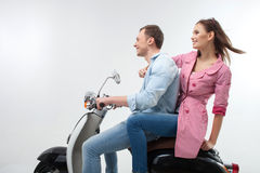 Attractive young man and woman on motorbike Royalty Free Stock Images
