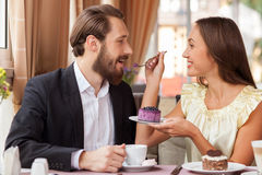 Attractive young man and woman are resting in cafe Royalty Free Stock Photos