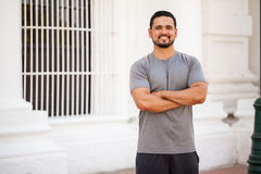 Attractive young man working out in the city. Portrait of a good looking young man with a beard doing some exercise outdoors in the city and smiling Stock Photography
