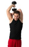 Attractive Young man working out with weights Stock Image