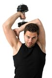 Attractive Young man working out with weights Royalty Free Stock Photos