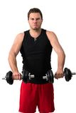 Attractive Young man working out with weights Royalty Free Stock Photo