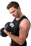 Attractive Young man working out with weights Royalty Free Stock Image