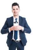 Attractive young manager or banker holding a cup of coffee Royalty Free Stock Photography