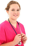 Attractive Young Medical Student. Attractive young female medical student over white with stethoscope Stock Photos