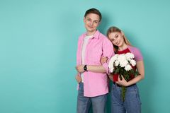 Attractive young man in pink shirt with his girlfriend that leaned on his shoulder stock photography