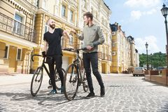 Attractive young men are walking in city Royalty Free Stock Photo