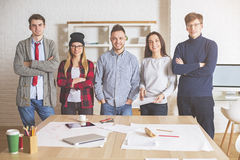 Attractive young men and women in office Royalty Free Stock Image