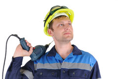 Attractive young men worker with a drill isolated Royalty Free Stock Photo