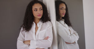 Attractive young mixed ethnic looking at mirror stock photo