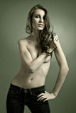 Attractive young model. Beautiful young model topless, covers her chest with arms Royalty Free Stock Photography