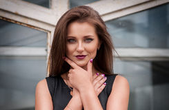 Attractive young model with bright make-up and manicure Stock Photo