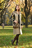 Attractive young model posing at Central Park for fall fashion Royalty Free Stock Photo