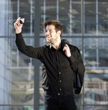 Attractive young modern man taking selfie Stock Image