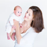Attractive young mother holding her newborn baby Royalty Free Stock Photography