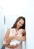 Attractive young mother holding newborn baby Stock Photography