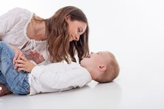 Attractive young mother is playing with her son Royalty Free Stock Photos