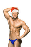 Attractive young muscle man smiling in Santa Claus Royalty Free Stock Image