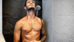 Attractive Young Muscular Man Taking Shower Royalty Free Stock Photos