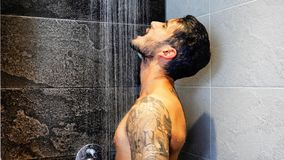 Attractive Young Muscular Man Taking Shower Stock Images
